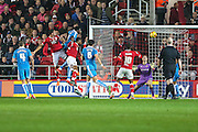 Bristol City's Jonathan Kodjia heads his teams 1st goal of the match during the Sky Bet Championship match between Bristol City and Wolverhampton Wanderers at Ashton Gate, Bristol, England on 3 November 2015. Photo by Shane Healey.