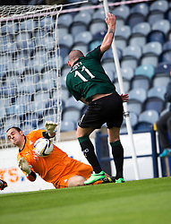 Falkirk's keeper Jamie MacDonald saves from Raith Rovers Martin Scott.<br /> half time : Raith Rovers 0 v 0 Falkirk, Scottish Championship game played 27/9/2014 at Raith Rovers Stark Park.