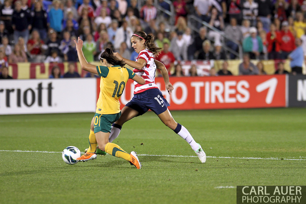 September 19, 2012 Commerce City, CO.  Australia d Yesim Servet Uzunlar (10) attempts to stop USA f Alex Morgan (13) during the Soccer Match between the USA Women's National Team and the Women's Australian team at Dick's Sporting Goods Park in Commerce City, Colorado
