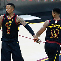 CLEVELAND, OH - JUN 3: JR Smith #5 of the Cleveland Cavaliers congratulates Tristan Thompson #13 of the Cleveland Cavaliers in Game Three of the 2018 NBA Finals won 110-102 by the Golden State Warriors over the Cleveland Cavaliers at the Quicken Loans Arena on June 6, 2018 in Cleveland, Ohio. NOTE TO USER: User expressly acknowledges and agrees that, by downloading and or using this photograph, User is consenting to the terms and conditions of the Getty Images License Agreement. Mandatory Copyright Notice: Copyright 2018 NBAE (Photo by Chris Elise/NBAE via Getty Images)