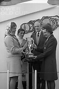 "The 'Powers' Gold Cup, Fairyhouse..1971..13.04.1971..04.13.1971..13th April 1971..The Running of the 'Powers' Gold Cup,sponsored by Irish Distillers, was run today at Fairyhouse, Co Meath..The race was won by 'Glending""ridden by John Donaghy. The horse is owned by Mr J.W.Osborne and trained by Mr P.D.Osborne..Photograph of Mrs Frank J O'Reilly,wife of the Chairman of Irish Distillers, presenting the Gold Cup to      Mrs P.D.Osborne,wife of the trainer. Included in the photograph are, jockey, John Donaghy and P.D.Osborne the trainer of 'Glending'."
