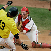 (OSUBB04 carrizo 05/03/09) OSU's catcher Shawn Forsythe, 41, waits to receive the ball as  Michigan's third baseman Tim Kalczynski slides to home plate and scores the 8th run for Michigan in the 8th inning of a NCAA baseball game between OSU and Michigan on Sunday, May 03, 2009 in Columbus, Ohio. OSU lost 9-2.<br /> (Columbus Dispatch Photo by Leonardo Carrizo)