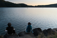 Backroads Guests Relaxing by Cascade Lake at Sunset, Moran State Park, Washington