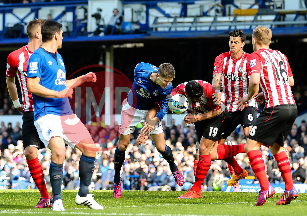 Everton's John Stones wins a header against Southampton's Graziano Pelle  - Photo mandatory by-line: Matt McNulty/JMP - Mobile: 07966 386802 - 04/04/2015 - SPORT - Football - Liverpool - Goodison Park - Everton v Southampton - Barclays Premier League