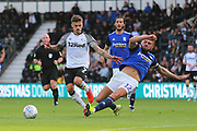 Derby County forward Jamie Paterson (7) is tackled by Birmingham City defender Harlee Dean (12) during the EFL Sky Bet Championship match between Derby County and Birmingham City at the Pride Park, Derby, England on 28 September 2019.