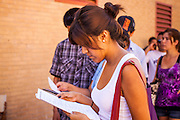 """25 AUGUST 2012 - PHOENIX, AZ:  A woman reads over the paperwork needed to apply for deferred action status during a workshop Saturday. Hundreds of people lined up at Central High School in Phoenix to complete their paperwork to apply for """"Deferred Action"""" status under the Deferred Action for Childhood Arrivals (DACA) program announced by President Obama in June. Volunteers and lawyers specialized in immigration law helped the immigrants complete the required paperwork. Under the program, the children of undocumented immigrants brought to the US before they turned 16 years old would not be subject to deportation if they meet a predetermined set of conditions.    PHOTO BY JACK KURTZ"""