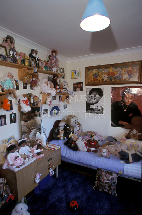 A Childs bedroom filled with cuddly toys and dolls, 2000's