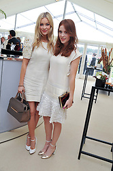 Left to right, LAURA WHITMORE and ANGELA SCANLON at the St.Regis International Polo Cup between England and South America held at Cowdray Park, West Sussex on 18th May 2013.  South America won by 11 goals to 9 goals.