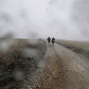 Two pilgrims in a snow storm near Sahagun, Leon province . Spain . The WAY OF SAINT JAMES or CAMINO DE SANTIAGO following the French Route, between Saint Jean Pied de Port and Santiago de Compostela in Galicia, SPAIN. Tradition says that the body and head of St. James, after his execution circa. 44 AD, was taken by boat from Jerusalem to Santiago de Compostela. The Cathedral built to keep the remains has long been regarded as important as Rome and Jerusalem in terms of Christian religious significance, a site worthy to be a pilgrimage destination for over a thousand years. In addition to people undertaking a religious pilgrimage, there are many travellers and hikers who nowadays walk the route for non-religious reasons: travel, sport, or simply the challenge of weeks of walking in a foreign land. In Spain there are many different paths to reach Santiago. The three main ones are the French, the Silver and the Coastal or Northern Way. The pilgrimage was named one of UNESCO's World Heritage Sites in 1993. When there is a Holy Compostellan Year (whenever July 25 falls on a Sunday; the next will be 2010) the Galician government's Xacobeo tourism campaign is unleashed once more. Last Compostellan year was 2004 and the number of pilgrims increased to almost 200.000 people.