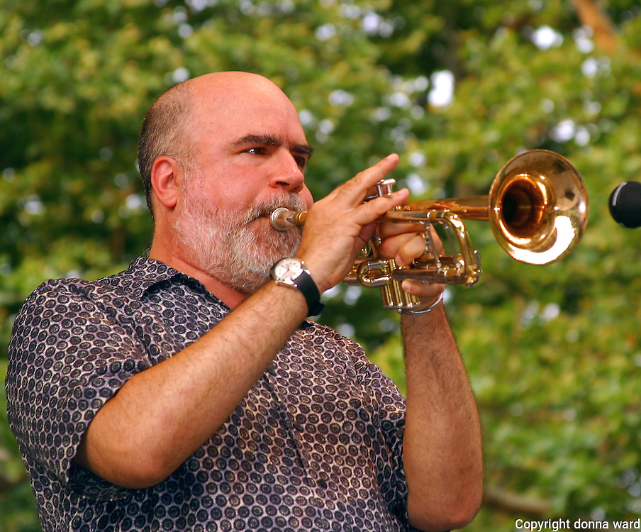 Randy Brecker performs at the Newport Jazz Festival All Stars event at  Central Park SummerStage on June 18, 2003.
