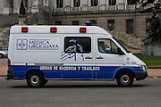Montevideo, Uruguay - An Ambulance drives infront of the house of Parliament in Montevideo