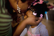 "Lettorea ""Lottie"" Clark, 25, kisses her daughter Gabby, 2, in the apartment they share in Albany, GA on Wednesday, October 22, 2008. Lottie and Gabby live off welfare after escaping an abusive relationship with Gabby's father."