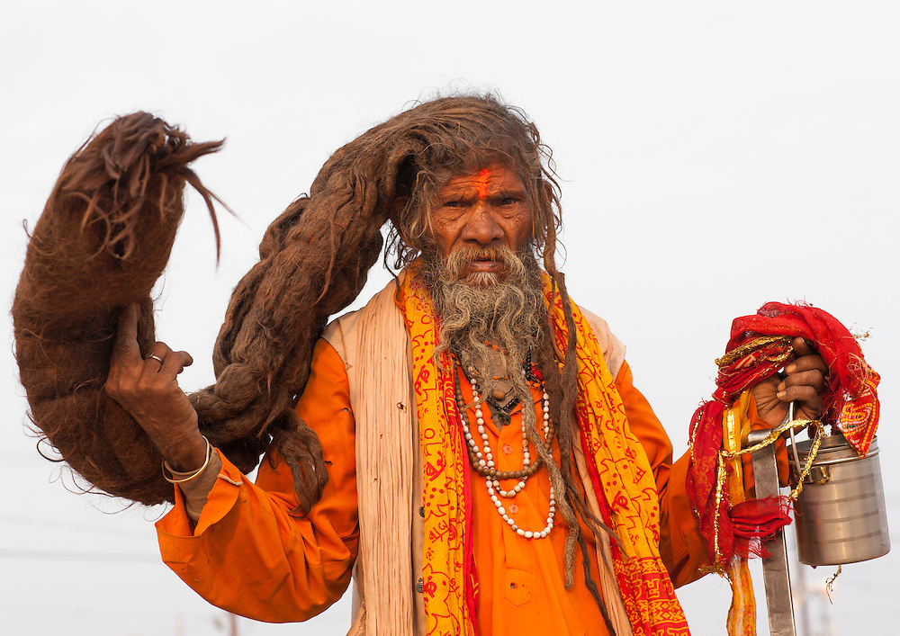 Naga Sadhu with very long hair. Maha Kumbh Mela festival, world's largest congregation of religious pilgrims. Allahabad, India.