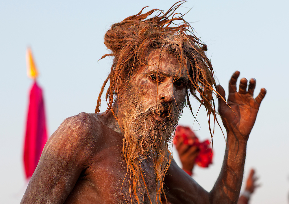 Naga Sadhu from Juna Akhara going to bath. Maha Kumbh Mela festival, world's largest congregation of religious pilgrims. Allahabad, India.