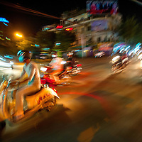 Jan 5, 2013 - Riding the streets of Phnom Penh looking for summer night life in the Cambodian capital city. Proper Kamir girls ride side saddle while cruising the streets in search of a place to see and be seen.<br /> <br /> Story Summary: Amidst the feverish pace of Phnom Penh&rsquo; city streets, a workhorse of transportation for people and goods emerges: Bicycles, motorcycles, scooters, Mopeds, motodups and Tuk Tuks roam in place of cars and trucks. Almost 90 percent of the vehicles roaming the Cambodian capital of almost 2.3 million people choose these for getting about. Congestion and environment both benefit from the small size and small engines. Business is booming in the movement of goods and and another one million annual tourists in Cambodia&rsquo;s moto culture.