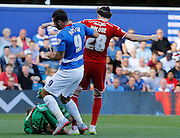 Simon Moore collects the ball to prevent any further danger from Charlie Austin during the Sky Bet Championship match between Queens Park Rangers and Cardiff City at the Loftus Road Stadium, London, England on 15 August 2015. Photo by Andy Walter.