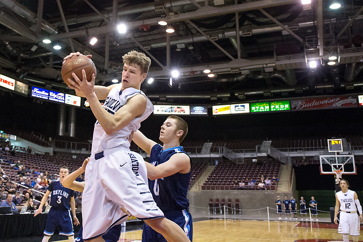 GABE GREEN/Press<br /> <br /> Lake City senior guard Jake Vetsch saves the ball from going out of bounds Thursday during the team&rsquo;s first game of the 2014 Real Dairy Shootout tournament against Skyline.