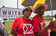 Sharon Lavinge on the first day of the Coalation of Deathy Alley's 5 day march through Cancer Alley, Louisiana in front of the Whitney Plantation with Robert Tayolr.
