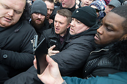 "© Licensed to London News Pictures . 18/03/2018 . London , UK . TOMMY ROBINSON (centre) pushes his way from the crowd to leave after delivering his speech . 1000s including supports of alt-right groups such as Generation Identity and the Football Lads Alliance , at Speakers' Corner in Hyde Park where Tommy Robinson reads a speech by Generation Identity campaigner Martin Sellner . Along with Brittany Pettibone , Sellner was due to deliver the speech last week but the pair were arrested and detained by police when they arrived in the UK , forcing them to cancel an appearance at a UKIP "" Young Independence "" youth event , which in turn was reportedly cancelled amid security concerns . Photo credit: Joel Goodman/LNP"