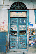Athens shop front doors, dishes, plates, lanterns, postcards, Greece, Europe.