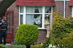 © Licensed to London News Pictures. 28/05/2019.<br /> Orpington,UK. Firefighters at the property this morning with one gaining access through a front window.  A woman has died at the scene of a house fire over night in Orpington, South East London, 25 firefighters were called to the fire at around 11pm. The cause of the fire is being investigated by Met police and London Fire Brigade. Photo credit: Grant Falvey/LNP