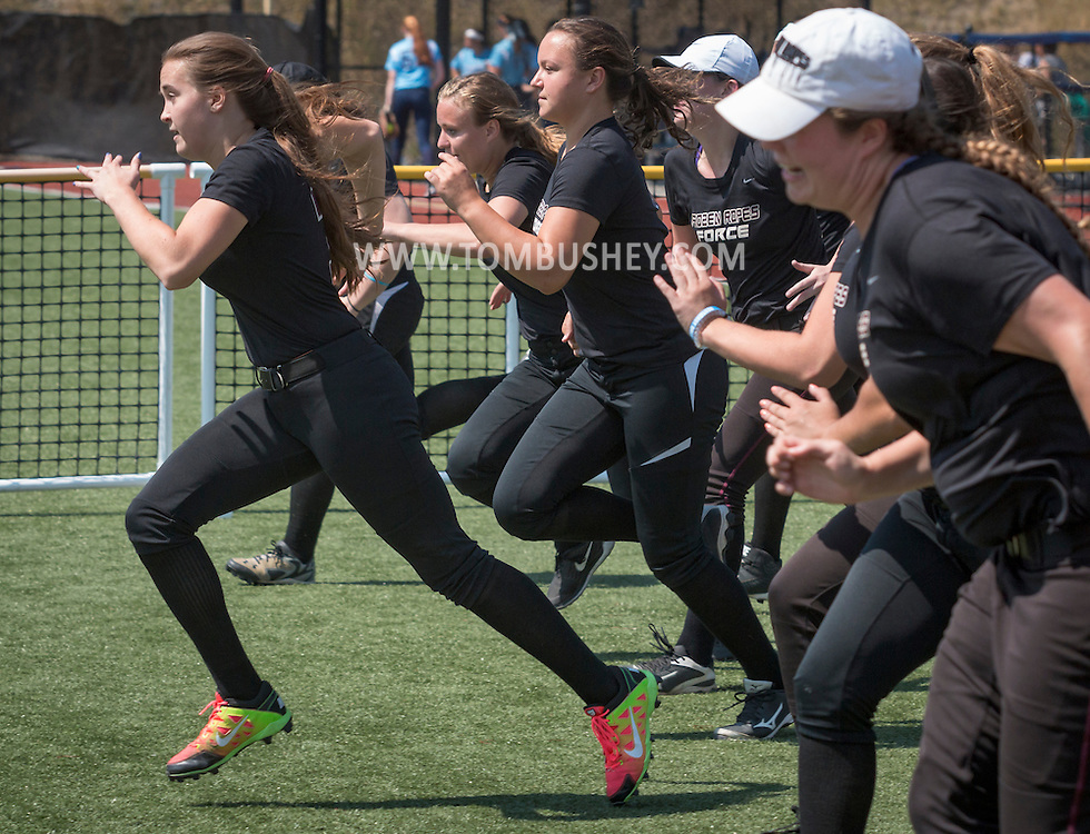 Chester, New York - Girls play in a softball tournament at The Rock on July 8, 2016.