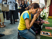 14 DECEMBER 2015 - BANGKOK, THAILAND:   Women pray for the Supreme Patriarch before the start of his funeral at Wat Bowon Niwet in Bangkok. Somdet Phra Nyanasamvara, who headed Thailand's order of Buddhist monks for more than two decades and was known as the Supreme Patriarch, died Oct. 24, 2013, at a hospital in Bangkok. He was 100. He was ordained as a Buddhist monk in 1933 and appointed as the Supreme Patriarch in 1989. He was the spiritual advisor to Bhumibol Adulyadej, the King of Thailand when the King served as a monk in 1956. His funeral, which will take three days,   Dec. 15-17, will be attended by thousands of Thais and most of the Royal Family. Buddhist clergy from around the world are expected to attend.       PHOTO BY JACK KURTZ