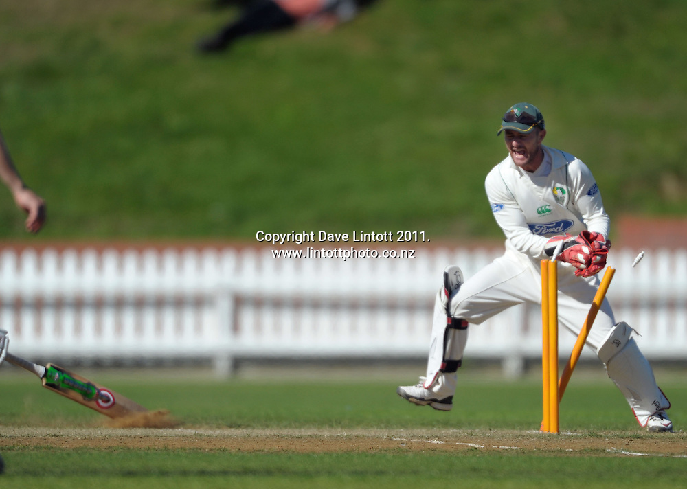 Stags keeper Kruger Van Wyk attempts a runout on Stewart Murdoch. Plunket Shield cricket - Wellington Firebirds v Central Stags day two at Hawkins Basin Reserve, Wellington, New Zealand on Tuesday, 29 March 2011. Photo: Dave Lintott / lintottphoto.co.nz