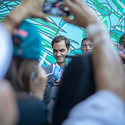 PARIS, FRANCE June 02.  Roger Federer of Switzerland signs autographs and speaks with fans after his media commitments following his victory against Leonardo Mayer of Argentina during the Men's Singles fourth round match on Court Philippe-Chatrier at the 2019 French Open Tennis Tournament at Roland Garros on June 2nd 2019 in Paris, France. (Photo by Tim Clayton/Corbis via Getty Images)