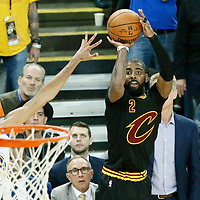 04 June 2017: Cleveland Cavaliers guard Kyrie Irving (2) takes a jump shot during the Golden State Warriors 132-113 victory over the Cleveland Cavaliers, in game 2 of the 2017 NBA Finals, at the Oracle Arena, Oakland, California, USA.