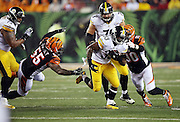 Pittsburgh Steelers running back Fitzgerald Toussaint (33) tries to elude tackle attempts by Cincinnati Bengals outside linebacker Vontaze Burfict (55) and Cincinnati Bengals defensive end Michael Johnson (90) during the NFL AFC Wild Card playoff football game against the Cincinnati Bengals on Saturday, Jan. 9, 2016 in Cincinnati. The Steelers won the game 18-16. (©Paul Anthony Spinelli)