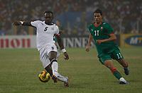 Photo: Steve Bond/Richard Lane Photography.<br />Ghana v Morocco. Africa Cup of Nations. 28/01/2008. John Mensah (L) clears from Monsef Zerka (R)