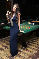 © Licensed to London News Pictures . 09/11/2013 . Manchester , UK . Louise Cliffe ex Big Brother at the roulette table .  Hearts and Minds charity ball in aid of children with autism , this evening (9th November 2013) at the Hilton Hotel on Deansgate in Manchester . Photo credit: Joel Goodman/LNP