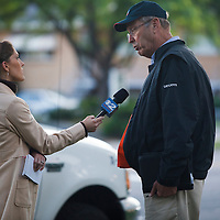 Chevron employee interviewed by local tv crew after oil spill, Liberty Park, Salt Lake City