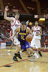 14 October 2006:  Ben Jacobson drives past defender Michael Vandello.....In a game that involved both coaches as much as the players, the Northern Iowa Panthers plucked the Illinois State University Redbirds in a Missouri Valley Conference game by a score of 67 - 52. Competition took place at Redbird Arena in Normal Illinois