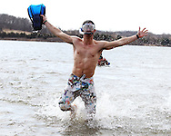 Raphael De Colnet, of Angers, France, exits the water at the Polar Plunge event at Pleasant Creek State Recreation Area in Palo on Saturday March 26, 2011. 28 team participated in the event which was sponsored by local law enforcement agencies and raised money for Special Olympics Iowa.