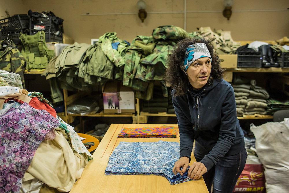 DNIPROPETROVSK, UKRAINE - NOVEMBER 16, 2014:  Lyudmyla Makaida, 48, a designer, arranges fabric which will be used to sew underwear for soldiers at the Dnipropetrovsk Volunteer Logistics Center, a charity organization that produces supplies for pro-Ukrainian fighters battling rebels in the country's East, in Dnipropetrovsk, Ukraine. CREDIT: Brendan Hoffman for The New York Times