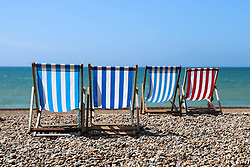© Hugo Michiels Photography. Brighton, UK. Deckchairs on Brighton beach. Photo Credit: Hugo Michiels