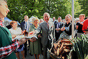 Repro Free No Charge for retro<br /> 11-5-17<br /> HRH Prince Charles and HRH The Duchess of Cornwall pictured at the Farmers Market in Kilkenny about to try some Dragons Fire health drink from one of the stalls.<br /> Picture Dylan Vaughan.