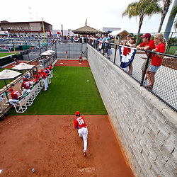 February 24, 2011; Clearwater, FL, USA; Fans watch Philadelphia Phillies pitcher Michael Stutes (68) throw in the bullpen during spring training exhibition game against Florida State University at Bright House Networks Field. Mandatory Credit: Derick E. Hingle