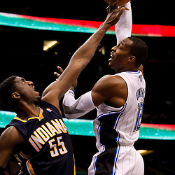 March 11, 2012; Orlando, FL, USA; Indiana Pacers center Roy Hibbert (55) blocks a shot by Orlando Magic center Dwight Howard (12) during the second quarter of a game at  Amway Center.   Mandatory Credit: Derick E. Hingle-US PRESSWIRE