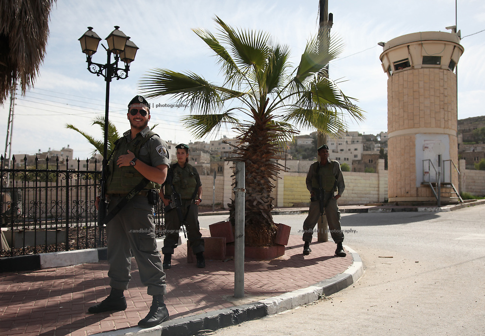 Soldier and police patrols the center of the westbank town Hebron. the majority muslim and the extreme minority of jewish settlers are divided by checkpoints and special security areas. Palestinian shops are closed. Hebron is a divided town. Armed settlers and israelis forces protect 400 jewish settlers in the towns heart, while about 200.000 palestinians must live under a regime of military law.