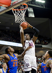 Texas A&M forward Robert Williams (44) makes a basket over Florida forward Keith Stone (25) during the first half of an NCAA college basketball game Tuesday, Jan. 2, 2018, in College Station, Texas. (AP Photo/Sam Craft)