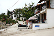 Greece, Thessaly, Lefokastro, a little fishing village on the Pagasetic Gulf. A man grilling a lamb in the street
