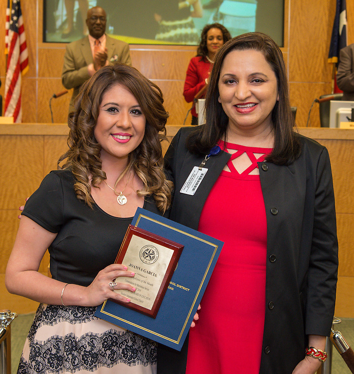 Joanna Garcia, left, is recognized as Employee of the Month by Jyoti Malhan, right, during a meeting of the Houston ISD Board of Trustees, December 10, 2015.