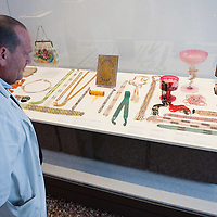 "VENICE, ITALY - DECEMBER 10: A museum technican checks the display of Murano pearls and jewelries at the press preview of the exhibition ""The Adventure of Glass"" at  Museo Correr on December 10, 2010 in Venice, Italy. After nearly thirty years Correr Museum is hosting a prestigious exhibition in celebration of over a thousands years history of glass in Venice and the Lagoon"