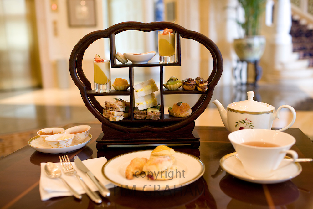 High tea at the Raffles Beijing Hotel, including sandwiches, cakes and scones, China