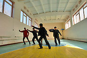 Students at Lyceum vocational school practice Tai Chi in the school's gymnasium.  The in-residence vocational school is home for more than 200 local boys and girls, ages 14-18. Here, they are taught the basics in high demand skills for the Bishkek region. The training in tailoring, mechanics, agriculture and services allow the children, who in most cases were abandoned, orphaned or simply poor; a better opportunity to gain employment in the local economy. Manas Air Base Outreach Society is a non-profit organization established at Manas Air Base in December 2003. Lyceum is one of its several focus groups that have donated more than 17,000 man-hours, $65,000 and 40,000 pounds of donations to heart operations, heating fuel, construction projects, elderly stipends, trips, and daily administration costs. (U.S. Air Force photo/Master Sgt. Lance Cheung)<br />