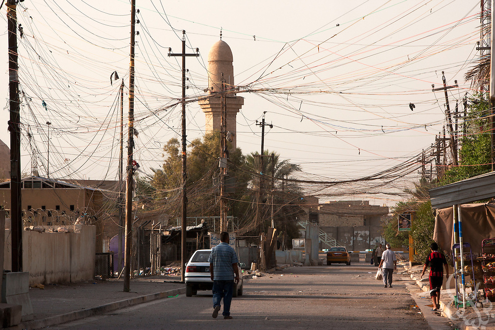 A tangle of hundreds of home-rigged electrical wires are seen extending down a Baghdad street August 23, 2010.  After seven years of conflict, Iraqis still rely heavily on the use of neighborhood or private generators as the iraqi civil electrical grid has struggled to keep pace with demand despite numerous projects to rebuild Iraq's infrastructure and electrical capacity.  .