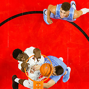 05 December 2018: San Diego State Aztecs forward Nathan Mensah (31) dunks the ball over San Diego Toreros guard Mitch Schafer (4) in the first half. The Aztecs lost to the Toreros 73-61 at Viejas Arena.